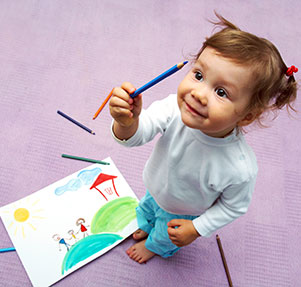 Little cute girl painting her family